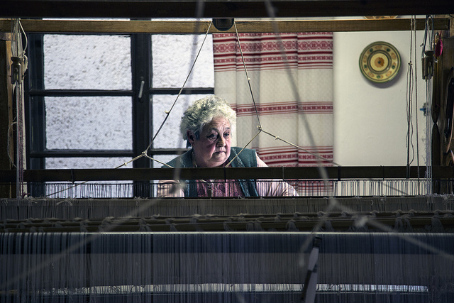 Old woman working at a loom. Photo by silas8six.