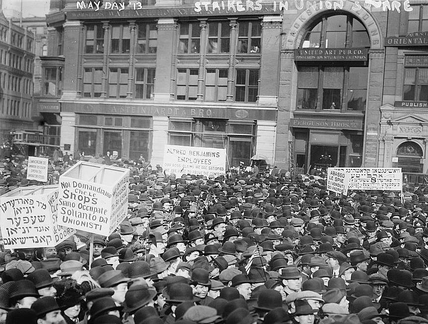 Demonstrators in New York City during the 1913 May Day parade. Signs feature Yiddish, Italian, and English. Photo via Library of Congress.