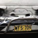 Angry car graffiti. Photo by Dushan Hanuska.